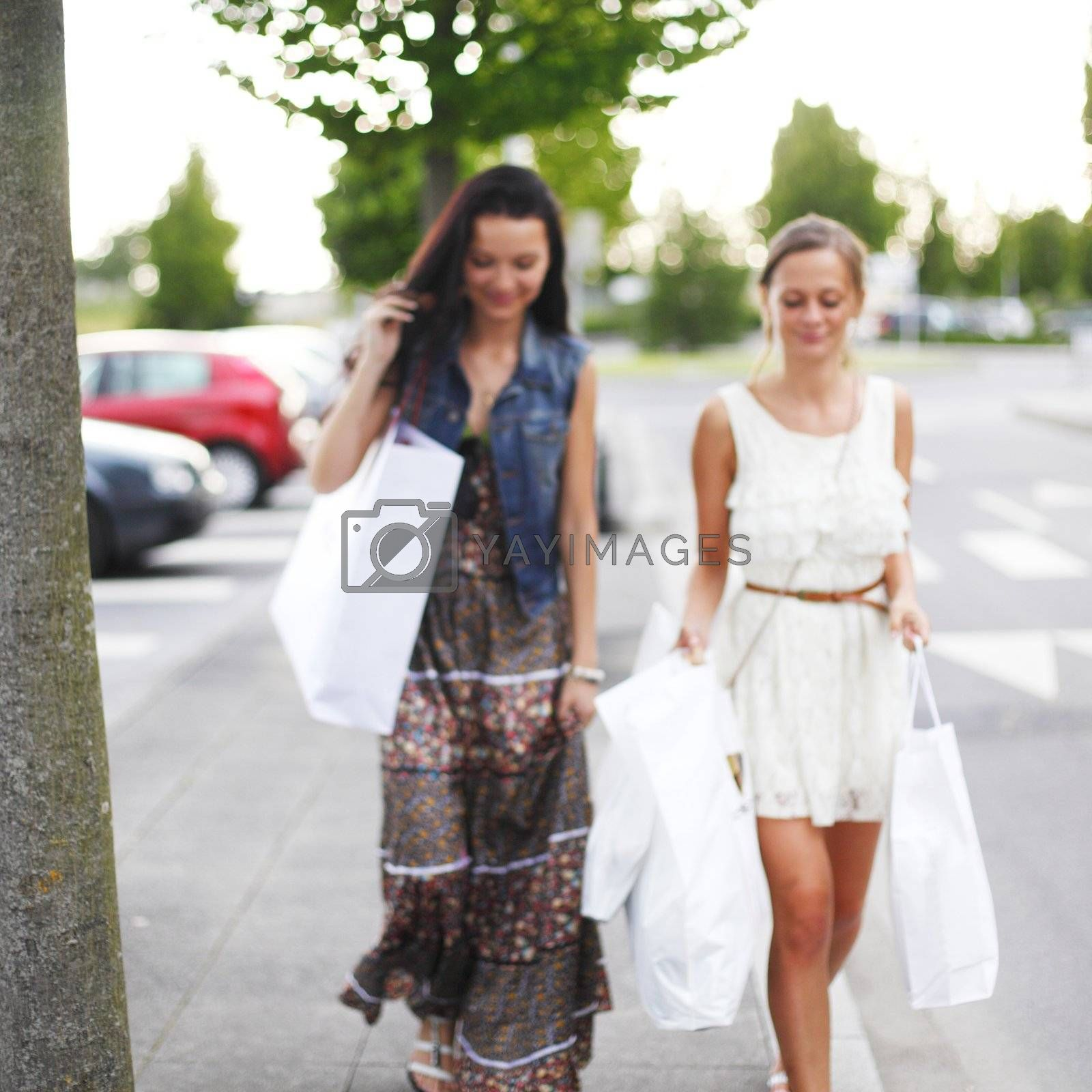 Two woman after shopping