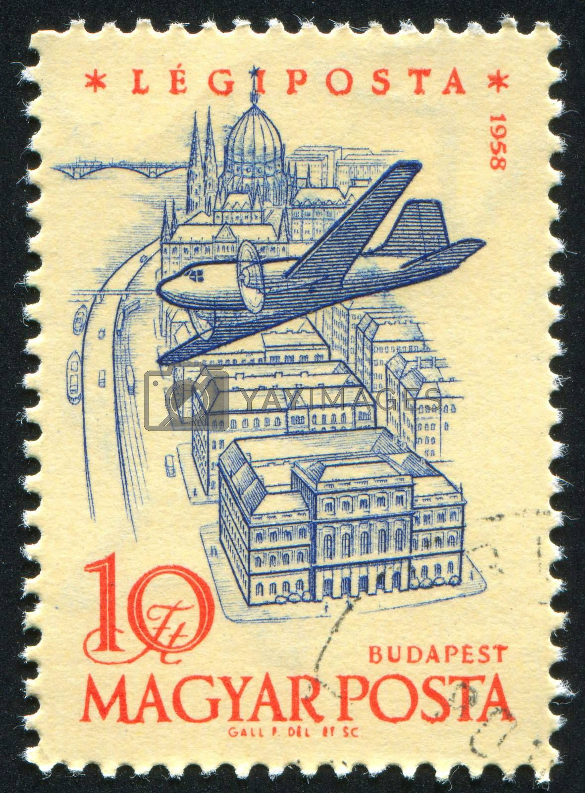 HUNGARY - CIRCA 1958: stamp printed by Hungary, shows Plane over Budapest, Academy of Science and Parliament, circa 1958