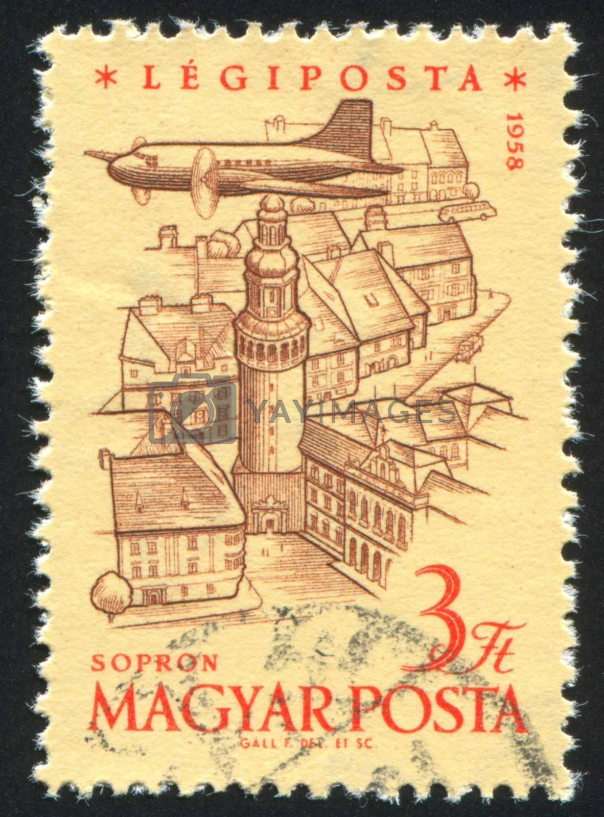 HUNGARY - CIRCA 1958: stamp printed by Hungary, shows Plane over Tower of Sopron, circa 1958