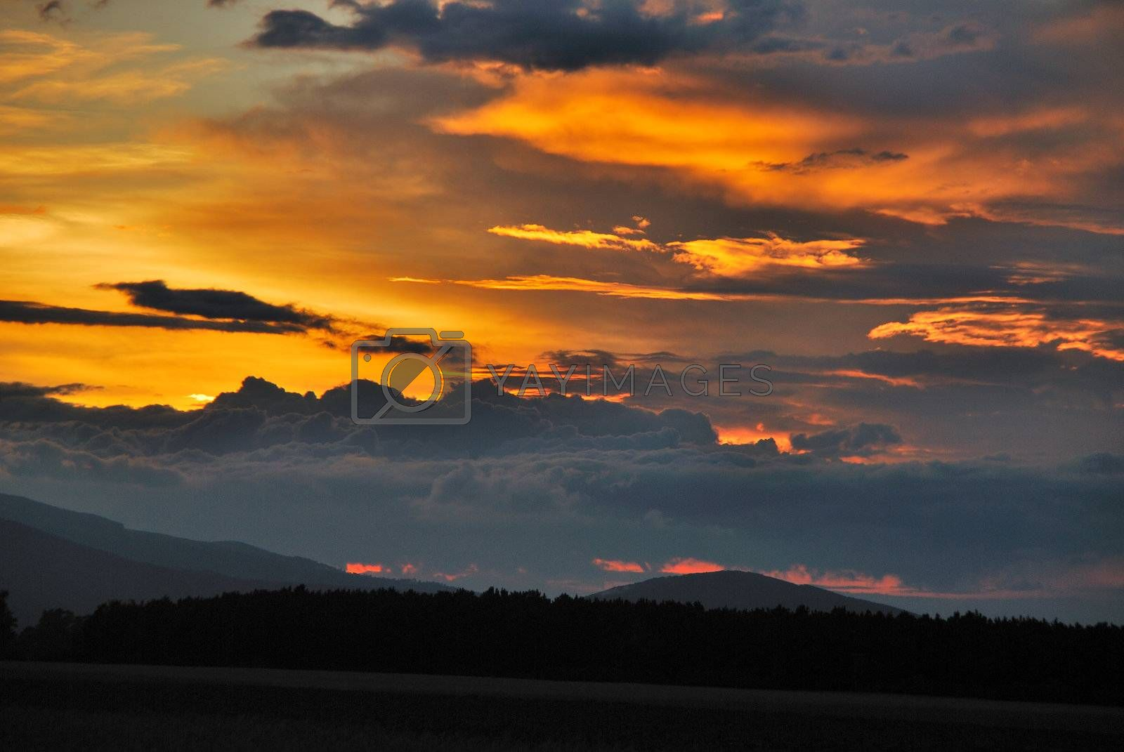 beautiful sunset with clouds and mountains