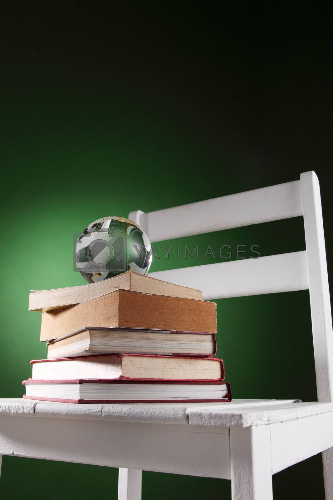 glass globe on top of stack of book