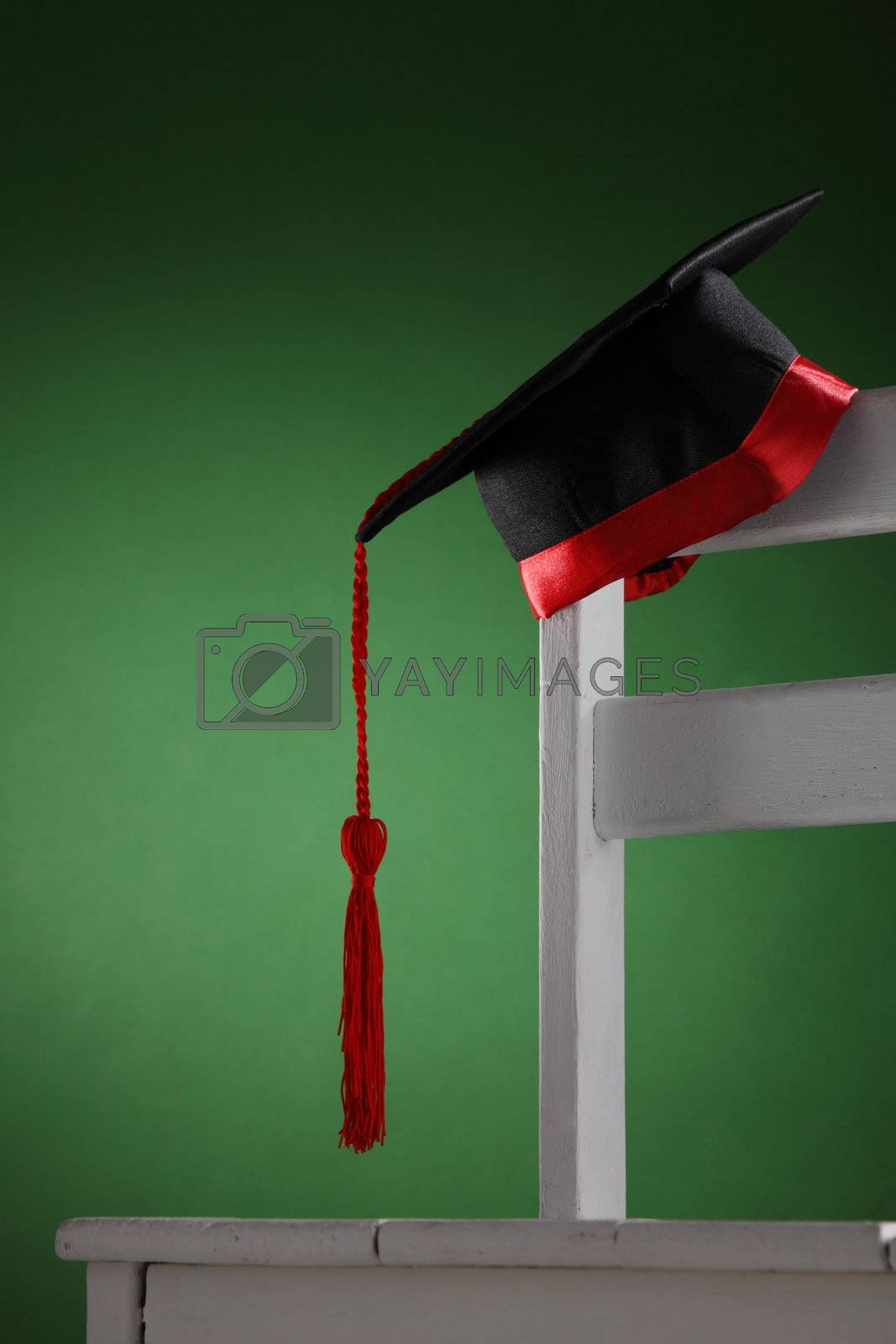 mortar board on the chair