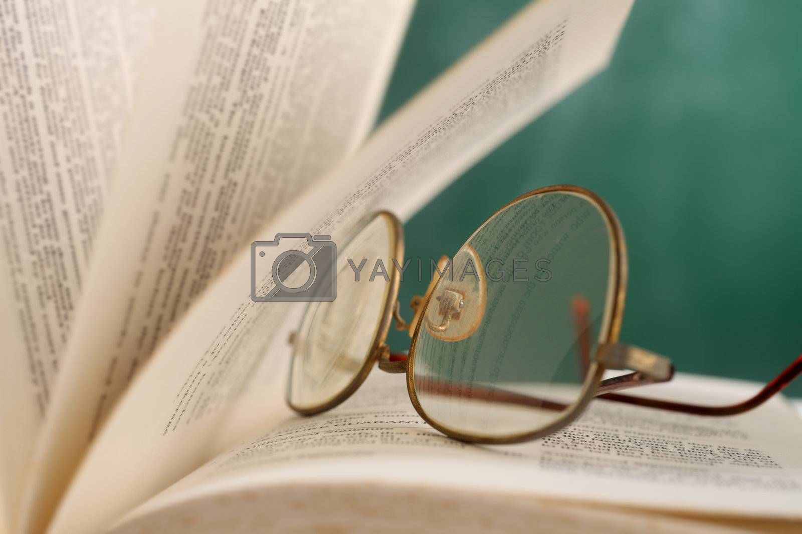 open page at glasses resting on the book