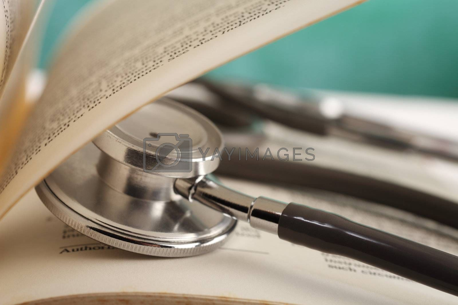 stethoscope resting on the book