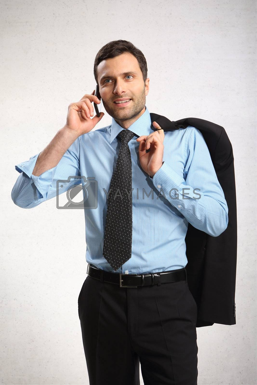 Portrait of young business man using cell phone