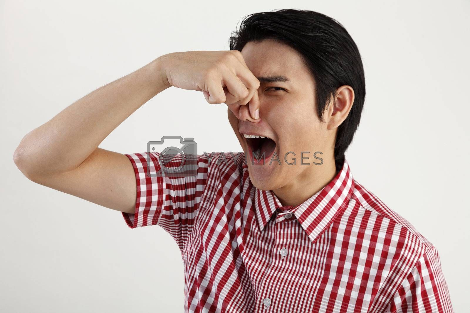 young man pressing his nose