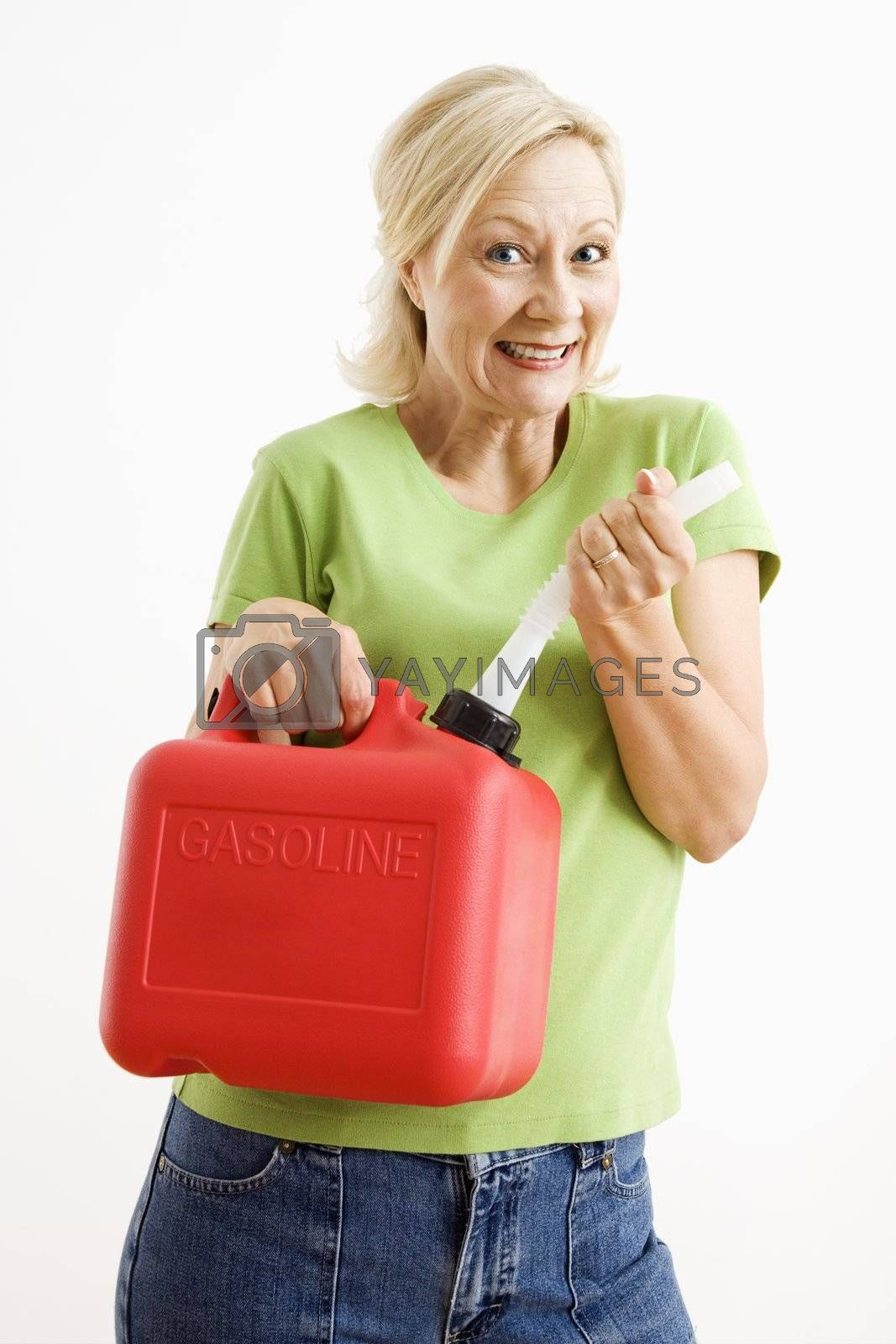 Portrait of smiling adult blonde woman holding gas can.