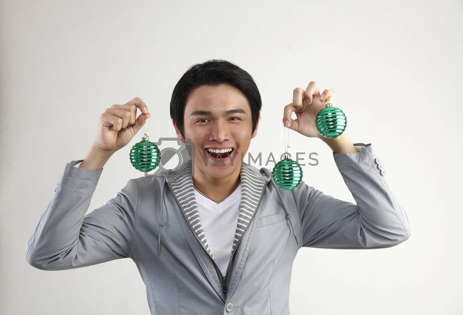 man holding Christmas Decoration on  White Background