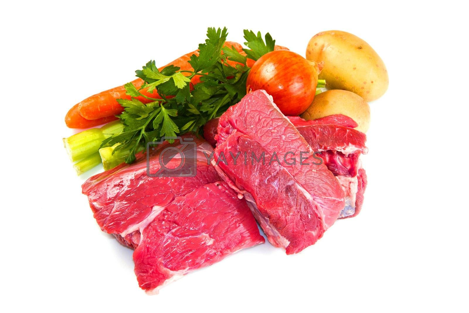Royalty free image of meat for boiled with fresh vegetables by lsantilli