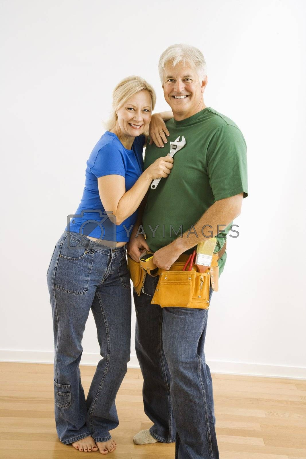 Middle-aged couple with household tools.