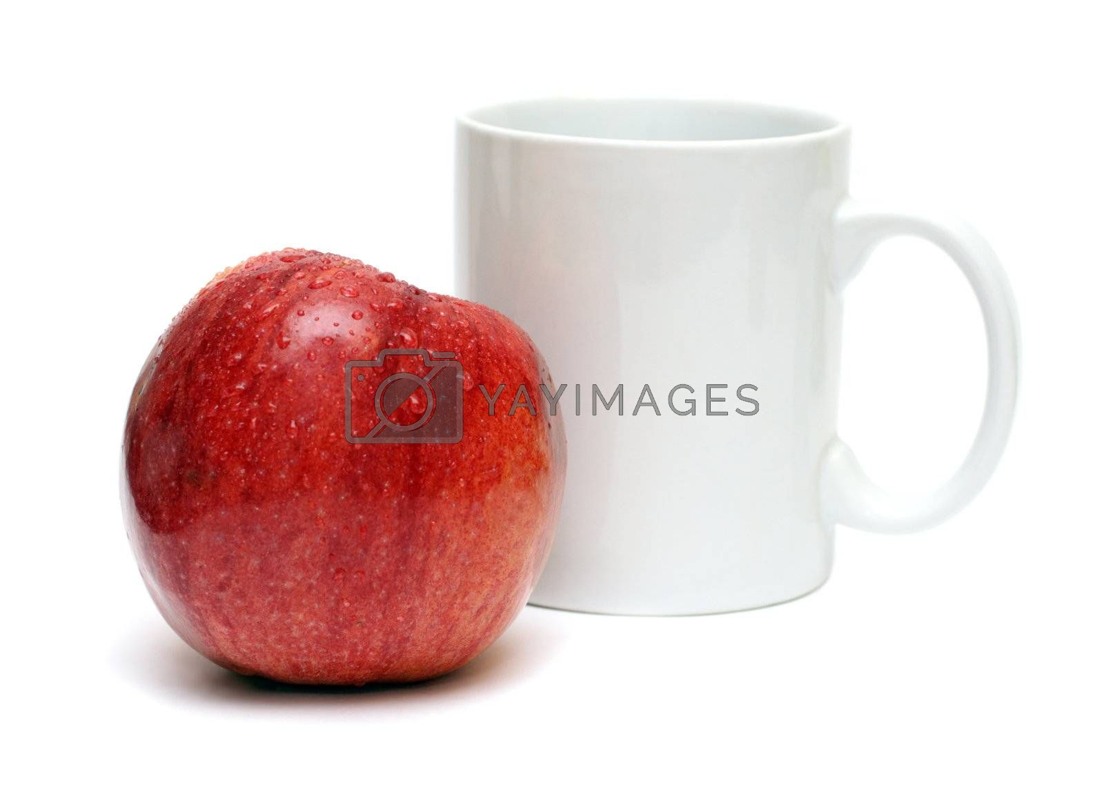 red apple and white mug isolated on white