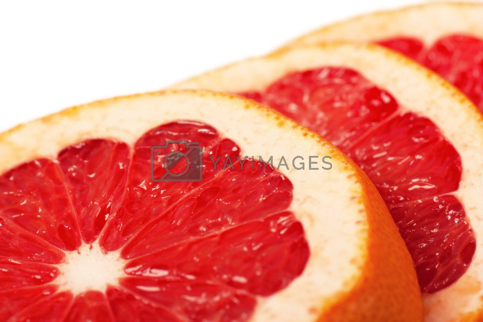 Macro view of fresh slices of grapefruit