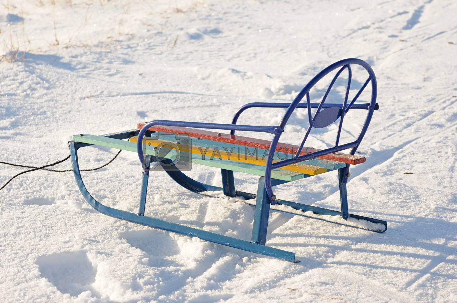 empty wooden sledge lying in the snow