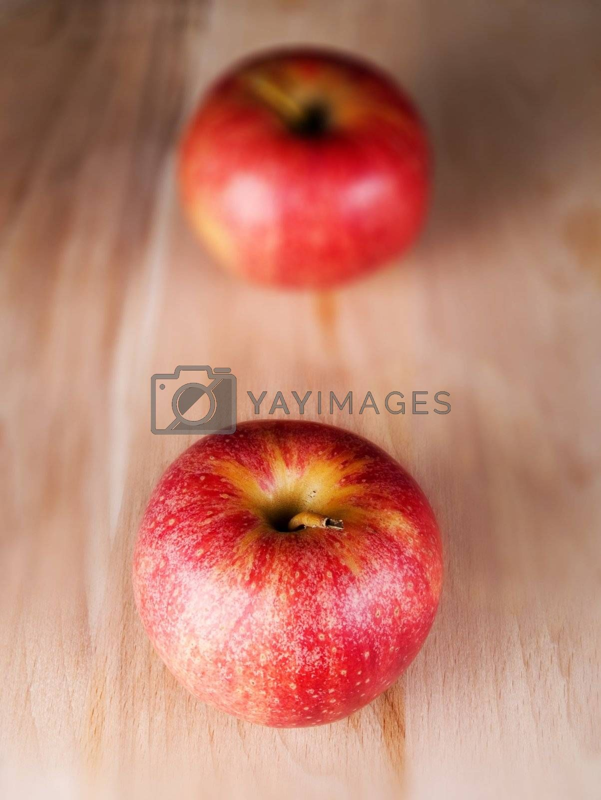 Two red apples in a kitchen