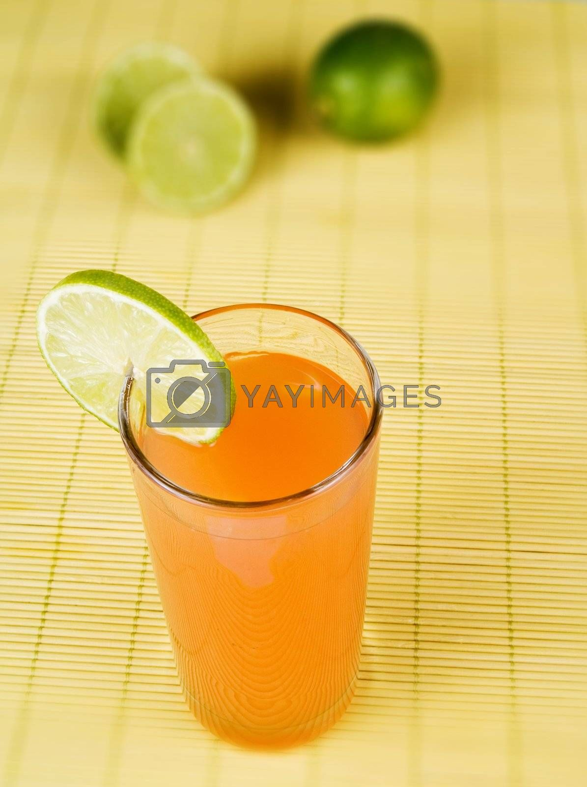 Orange juice with a lime slice