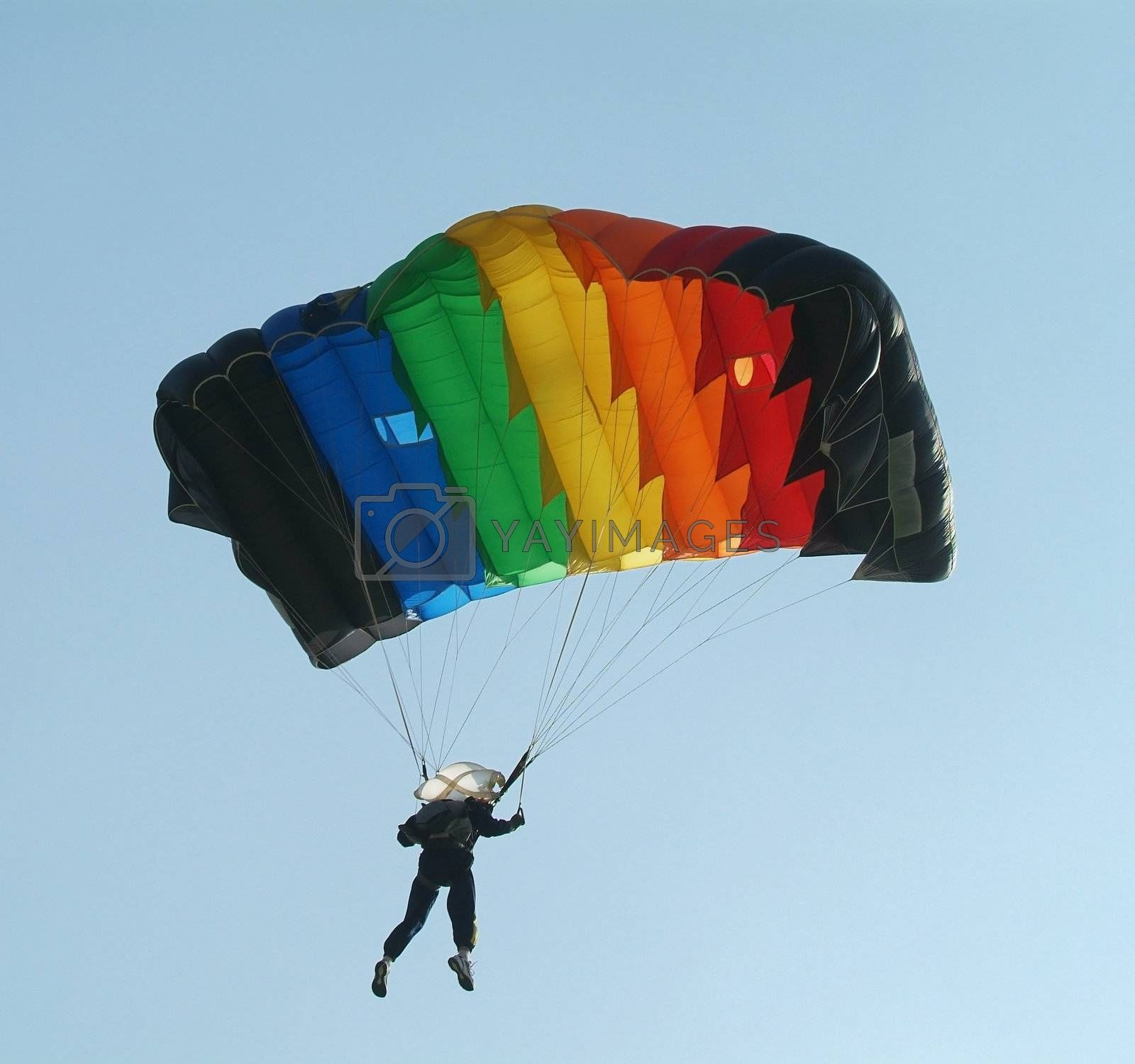 Parachutist with colourful parachute by epixx