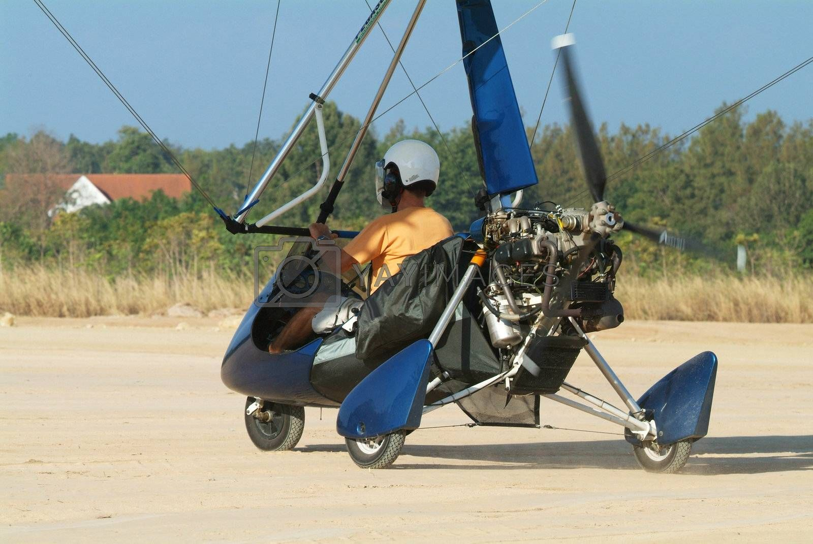 Microlight airplane on the ground by epixx