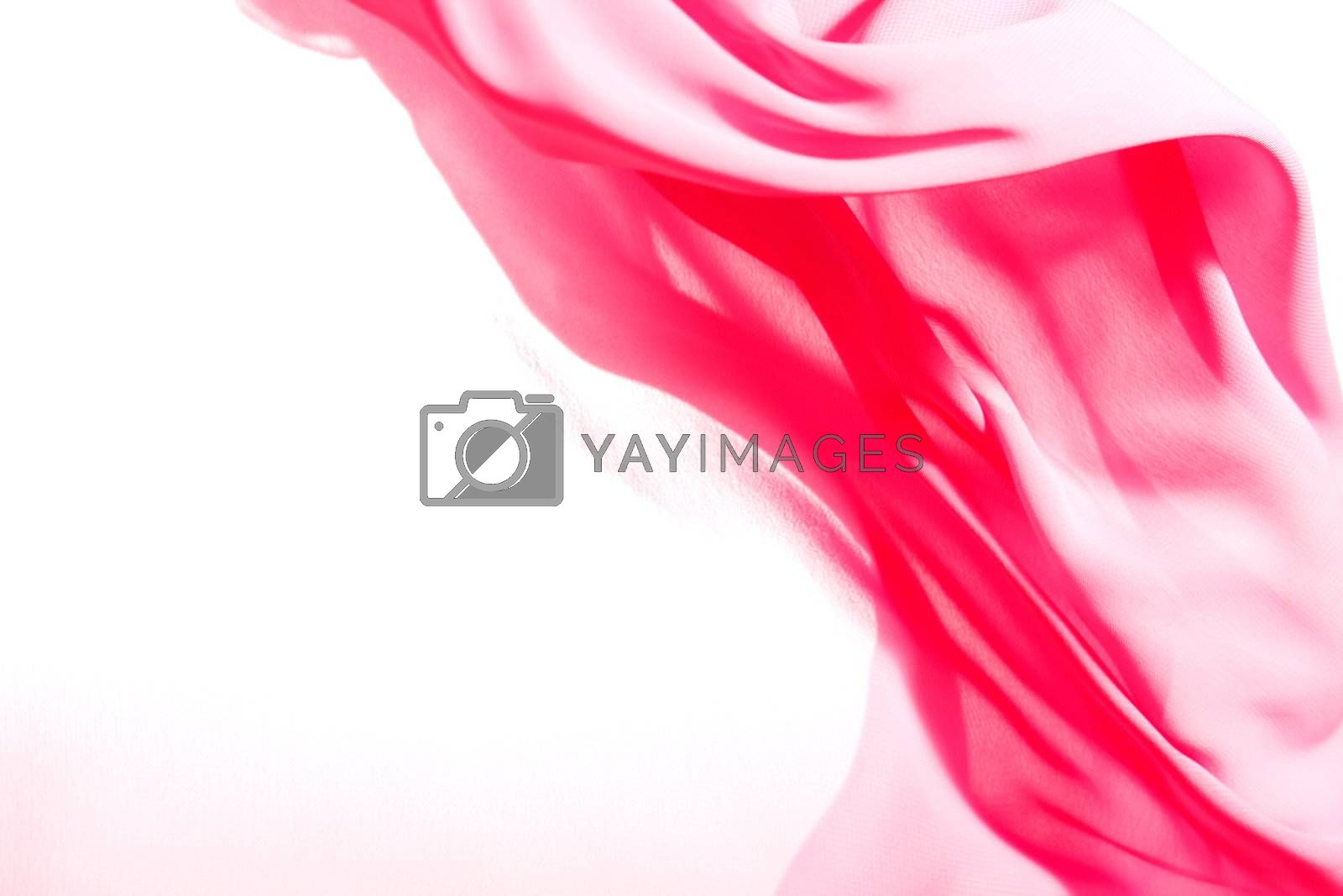 Pink fabric winds waves, creating a beautiful background of the folds