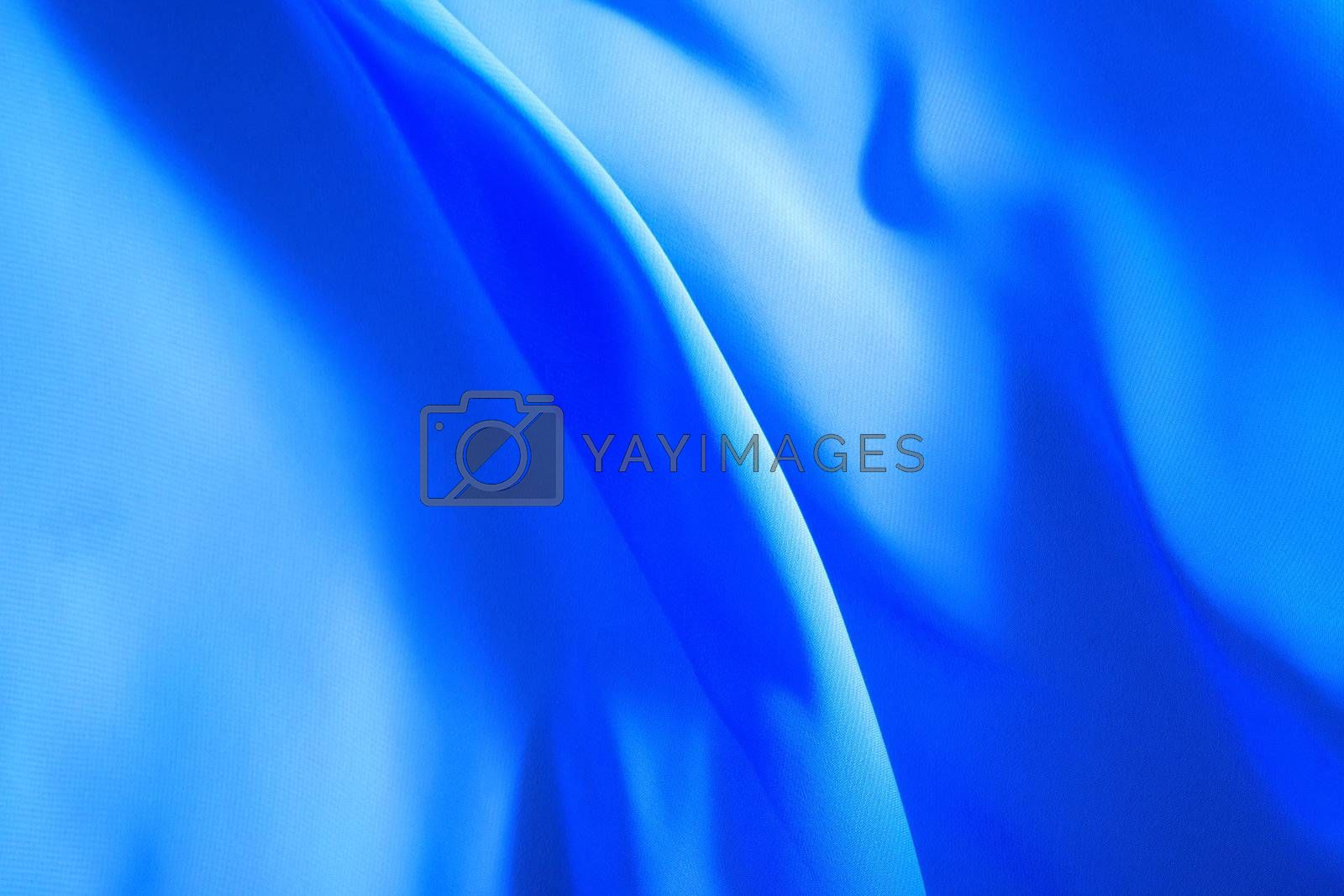 blue fabric winds waves, creating a beautiful background of the folds
