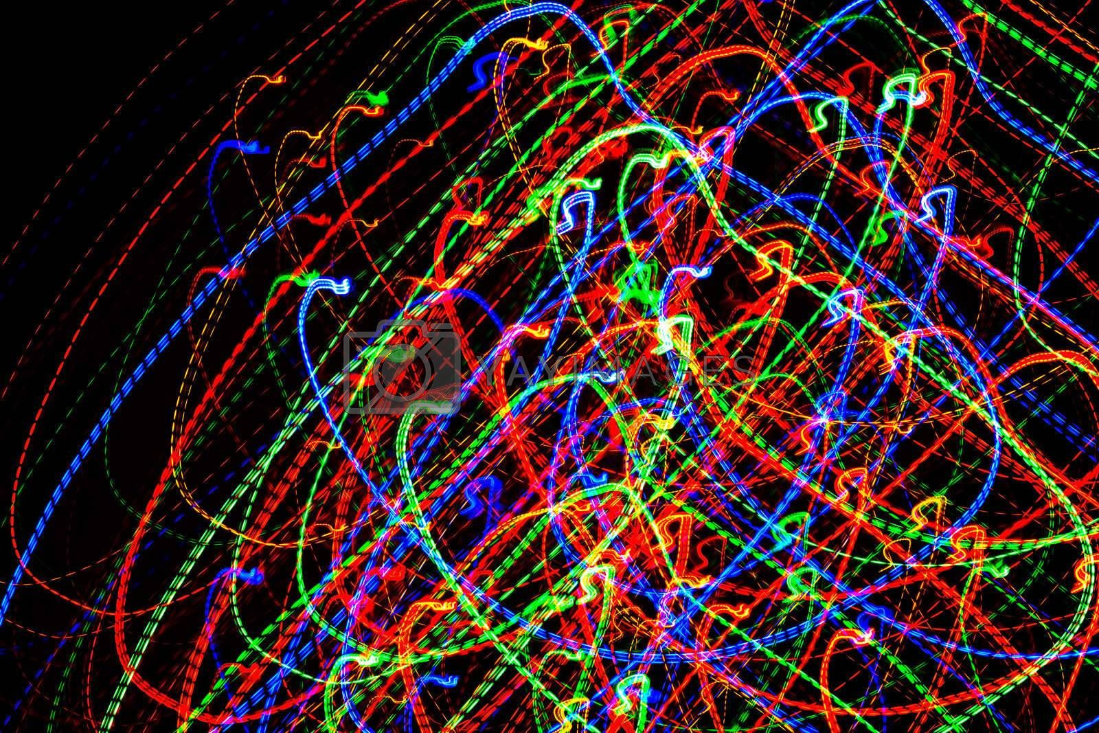 abstract glowing background resembling motion blurred neon light curves