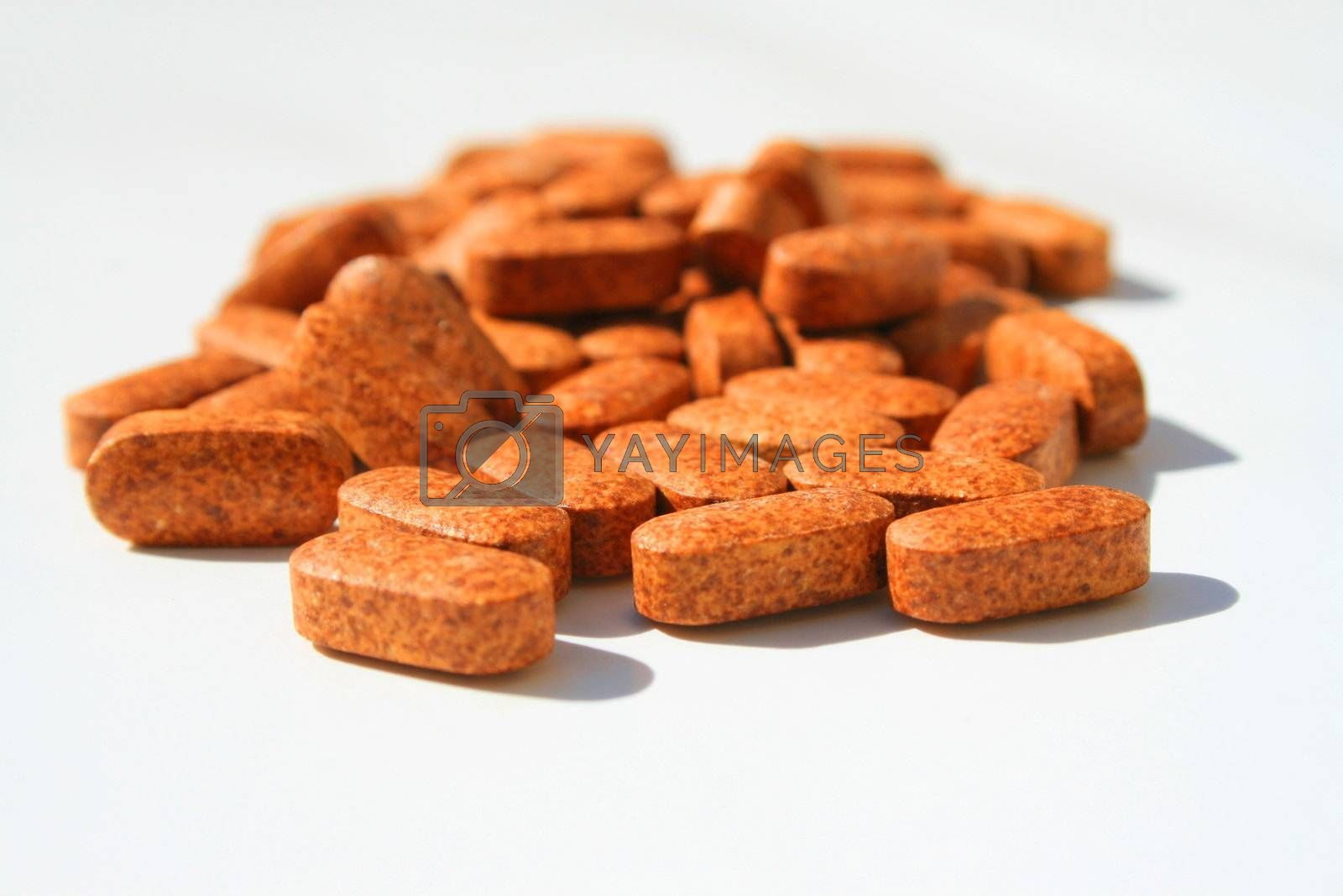 Close up of pills on a white background.