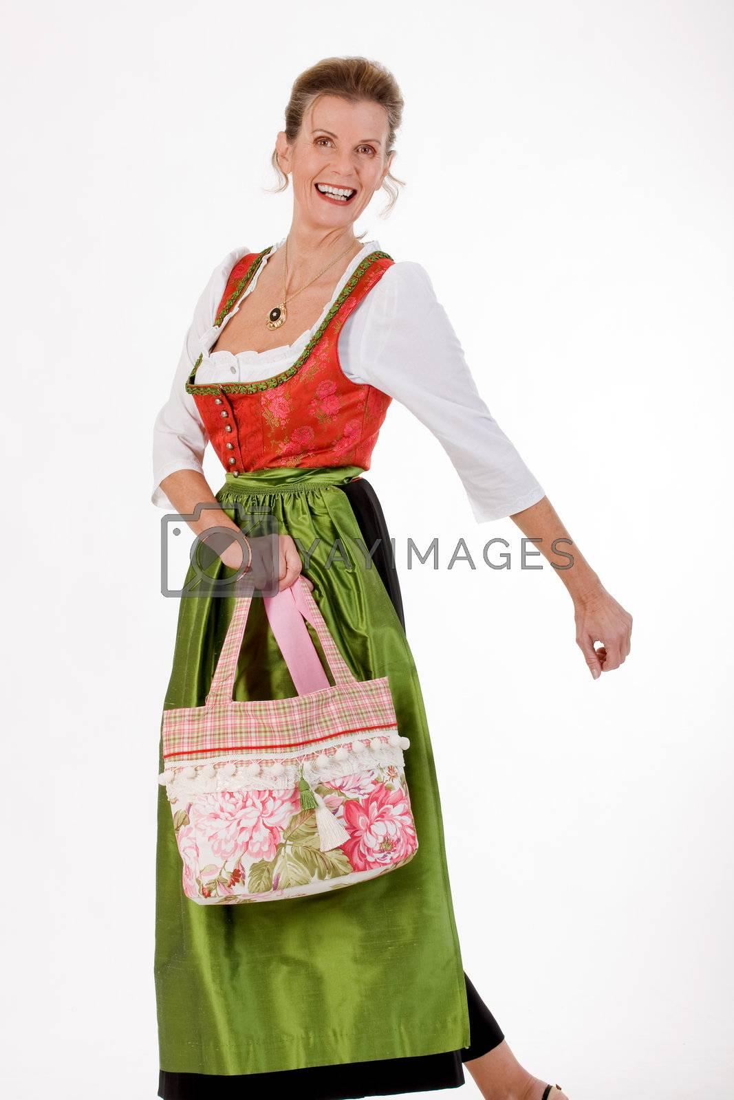 Elan full Bavarian costume elderly lady in dress and fashionable shopping bag