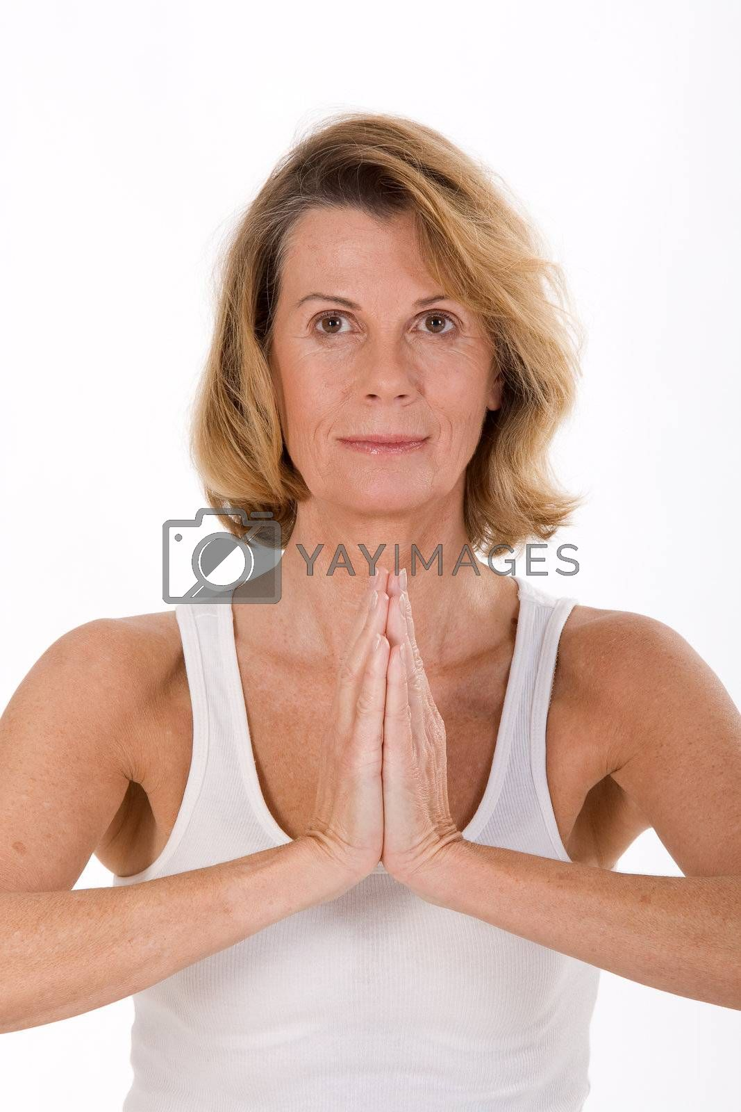 Portrait of a senior in yoga is the relaxation