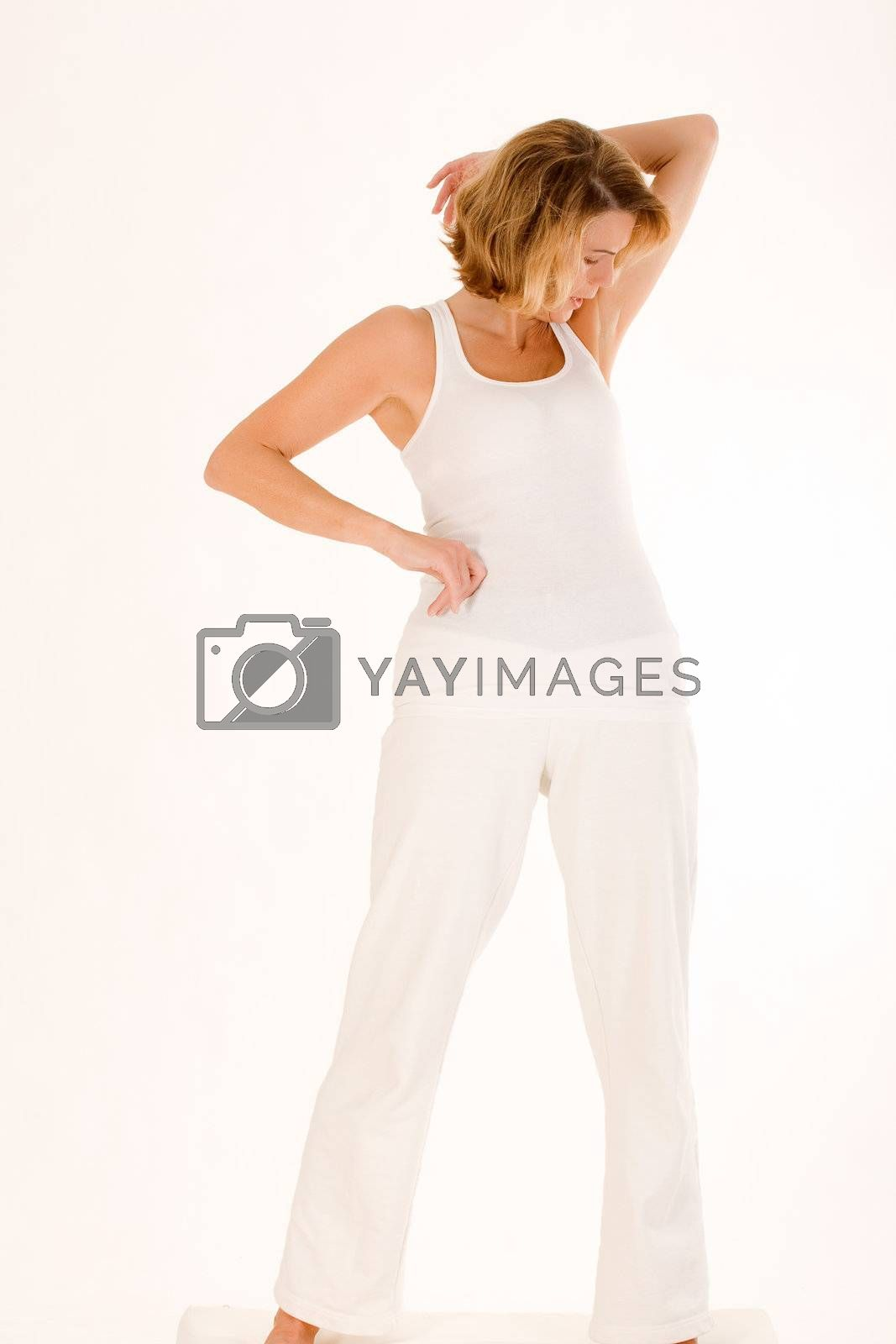 Elderly lady in a yoga exercise in standing