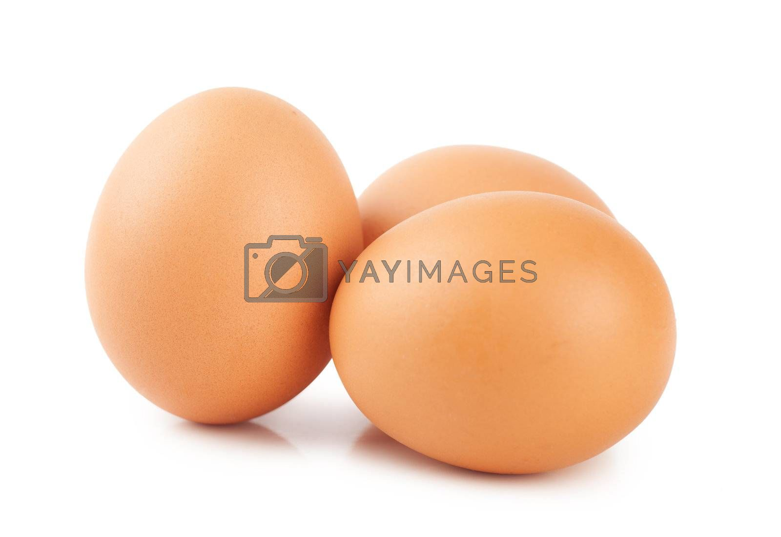 Closeup view of three brown eggs isolated on the white