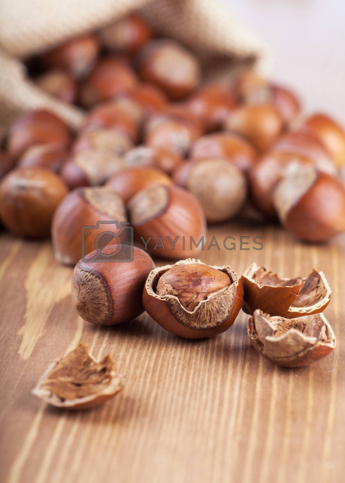 Closeup view of hazelnuts on a wooden table