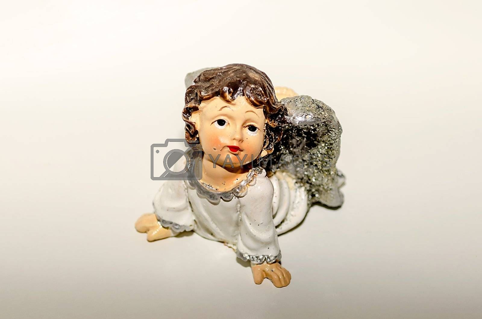 Ceramic Statuette of an Inspired Cute Angel, isolated on white