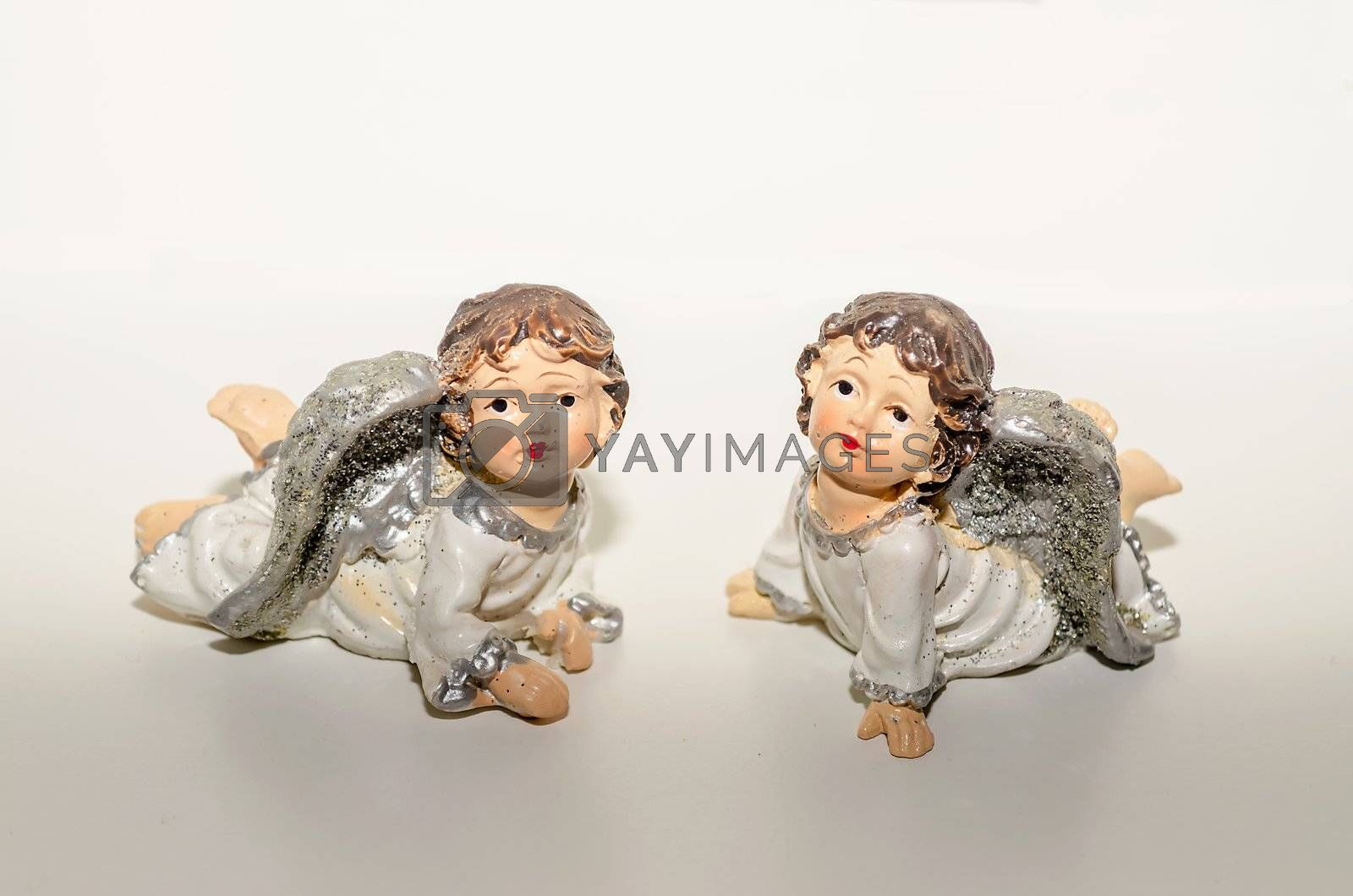 Ceramic Statuette of Two Cute Angels Close To Each Other, isolated on white
