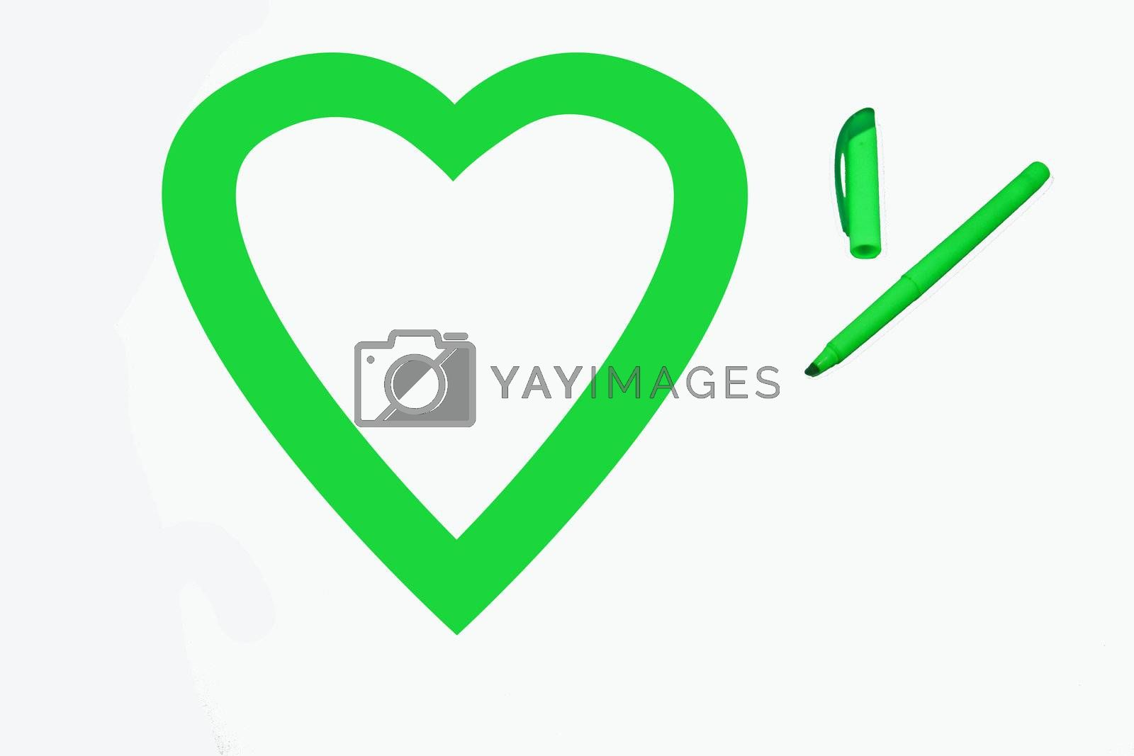 Heart shape colored green by office highlighter on white background