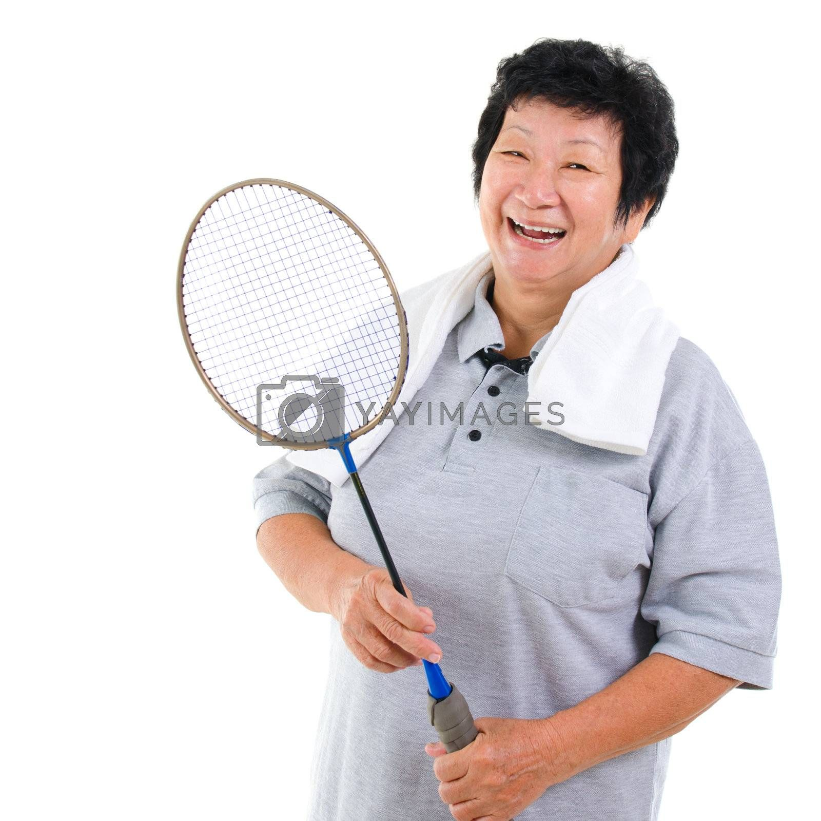 Asian senior woman healthy lifestyle. Happy Asian grandparent holding badminton racket isolated on white.
