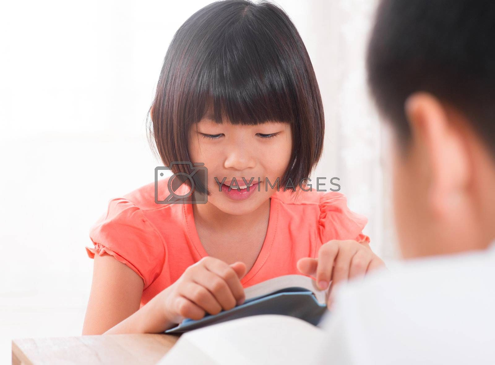 Southeast Asian children reading book at home, Asian family living lifestyle.