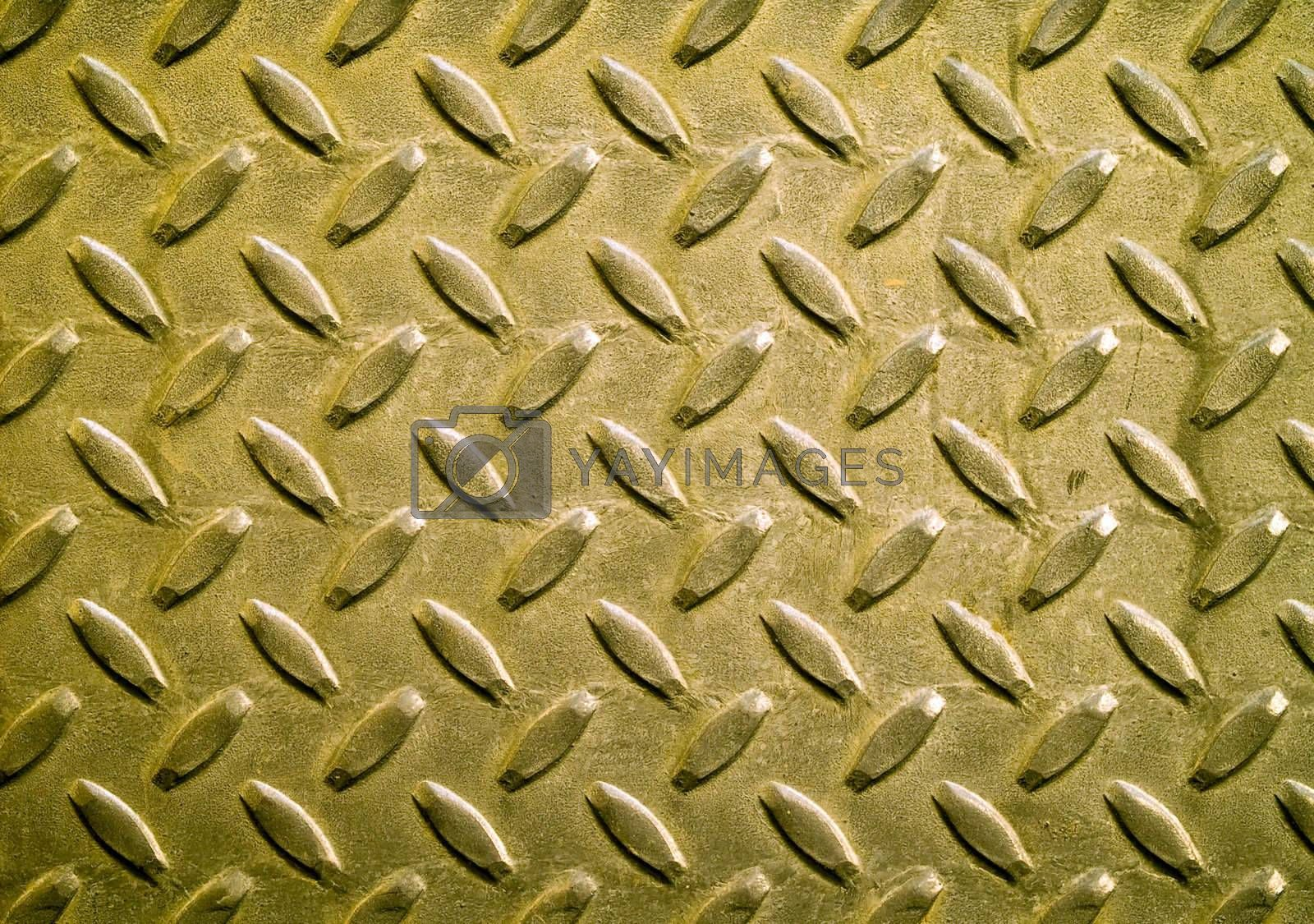 Diamond gold toned metal background texture illuminated by sunlight