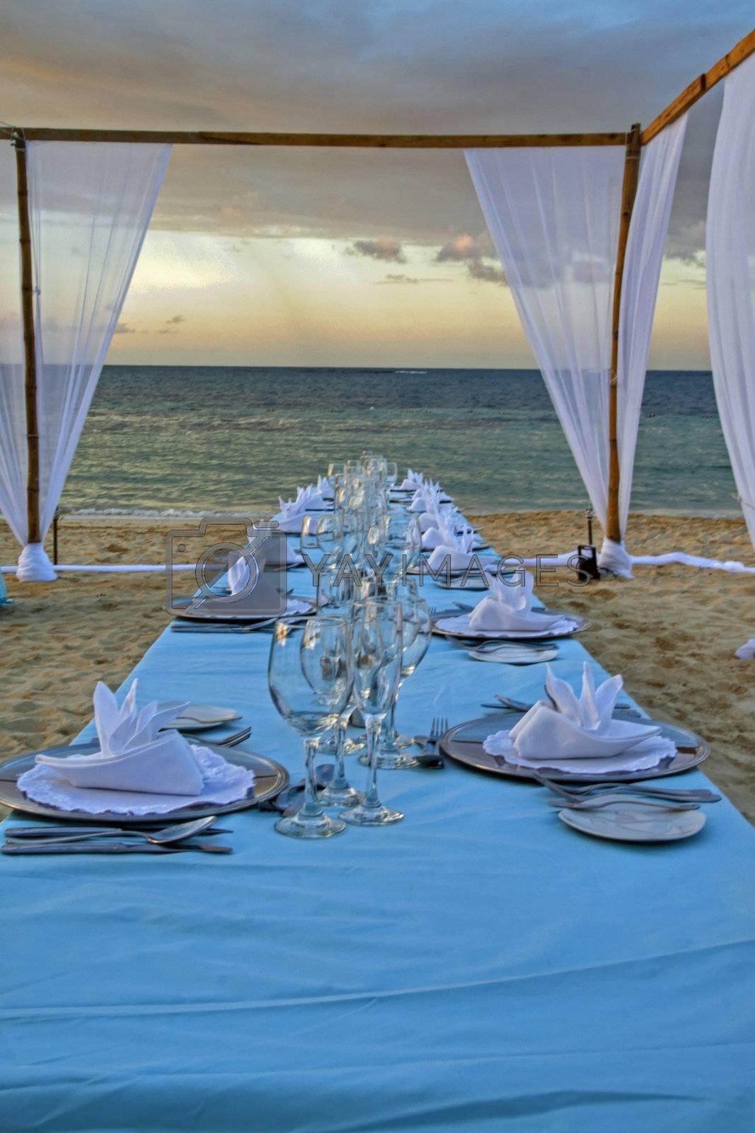 Exterior place setting for ocean side wedding celebration