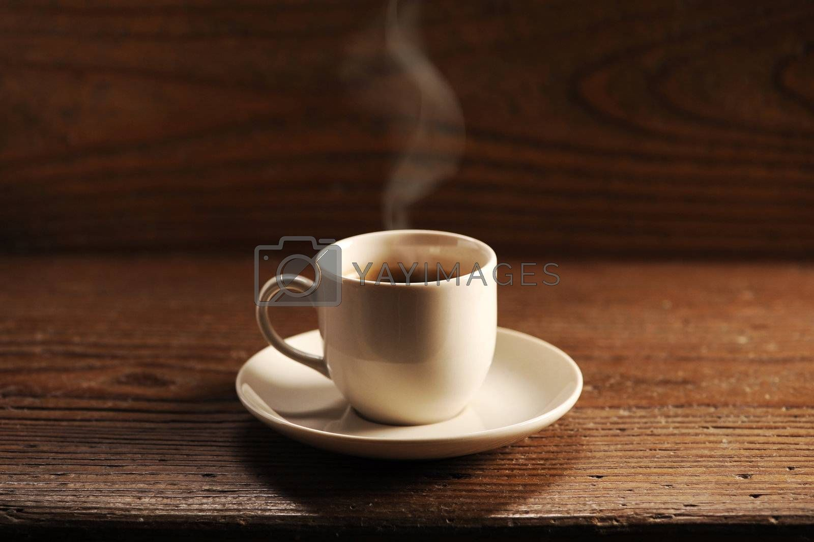 cup of coffee on the wooden table