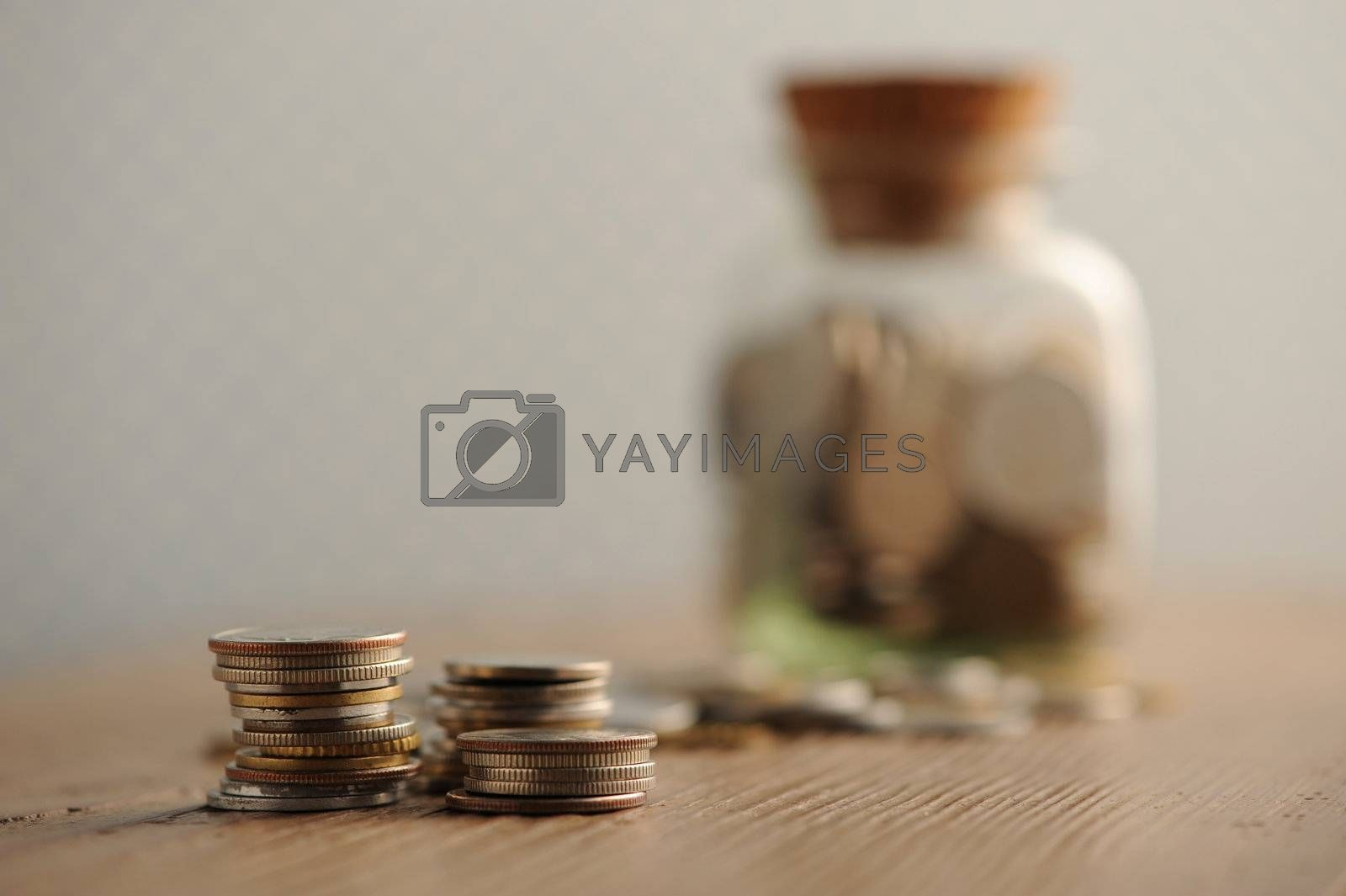 old coins on the wooden table, shallow dof