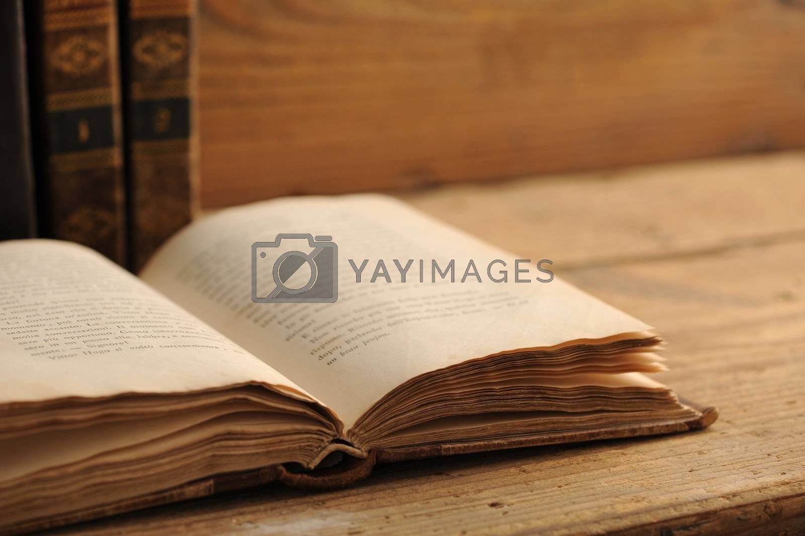 old book open on a wooden table