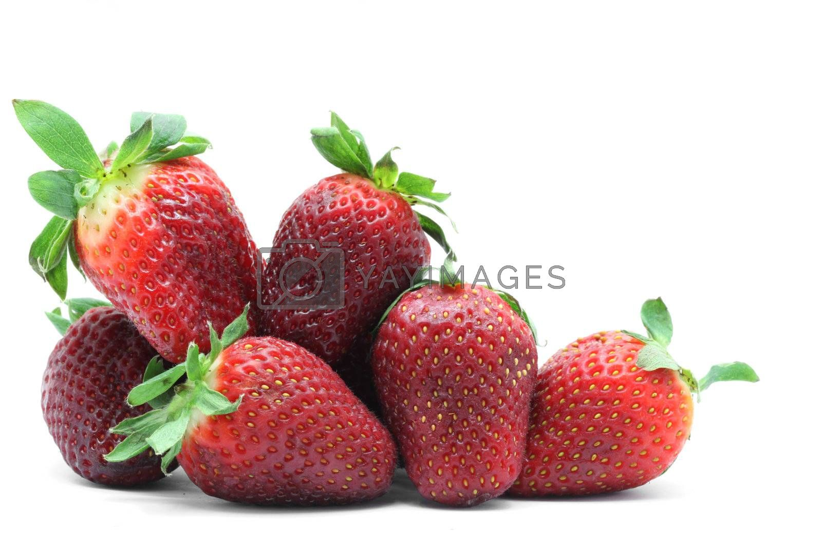 heap of strawberry fruit on white background