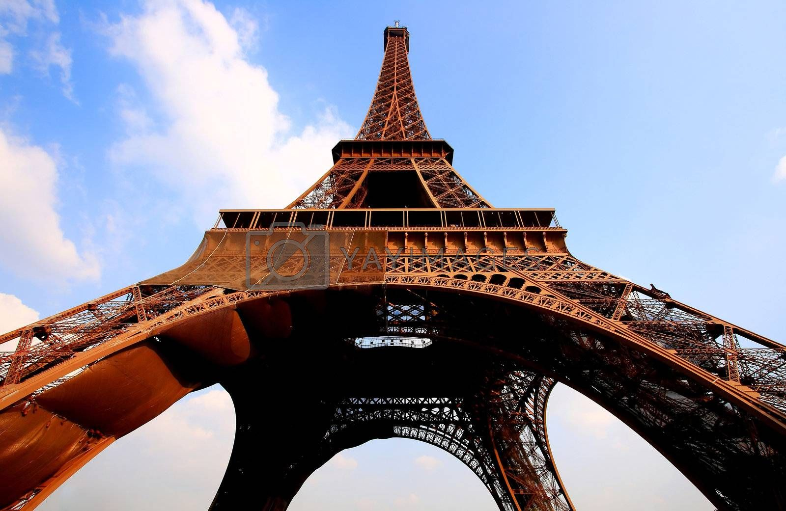 Eiffel tower in Paris with gorgeous colors and wide angle central perspective.