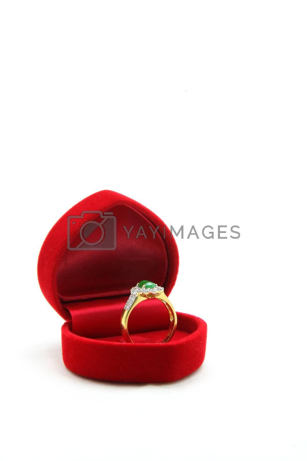 isolated female luxury diamond jade ring in red velvet box
