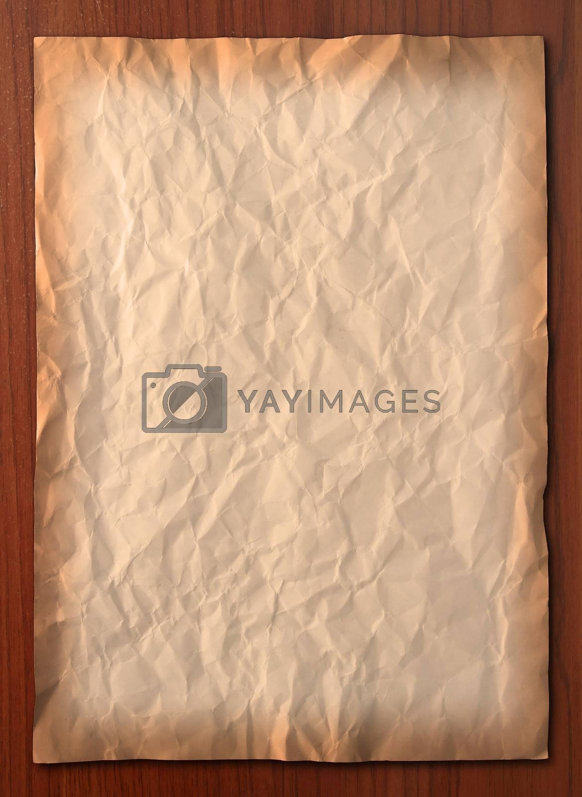 Wrinkled vintage paper on wooden board, Vertical
