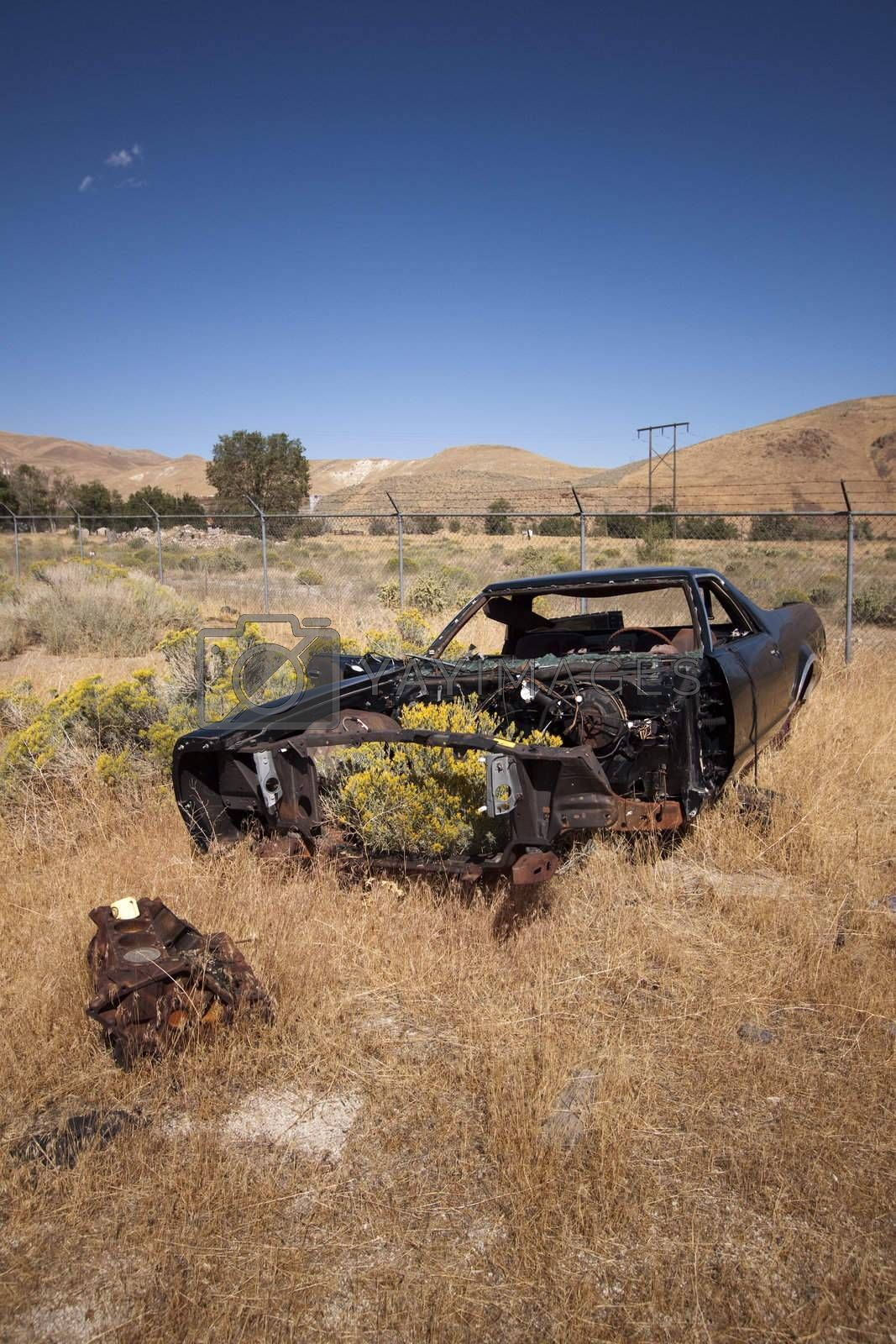 An old rusty abandoned car.