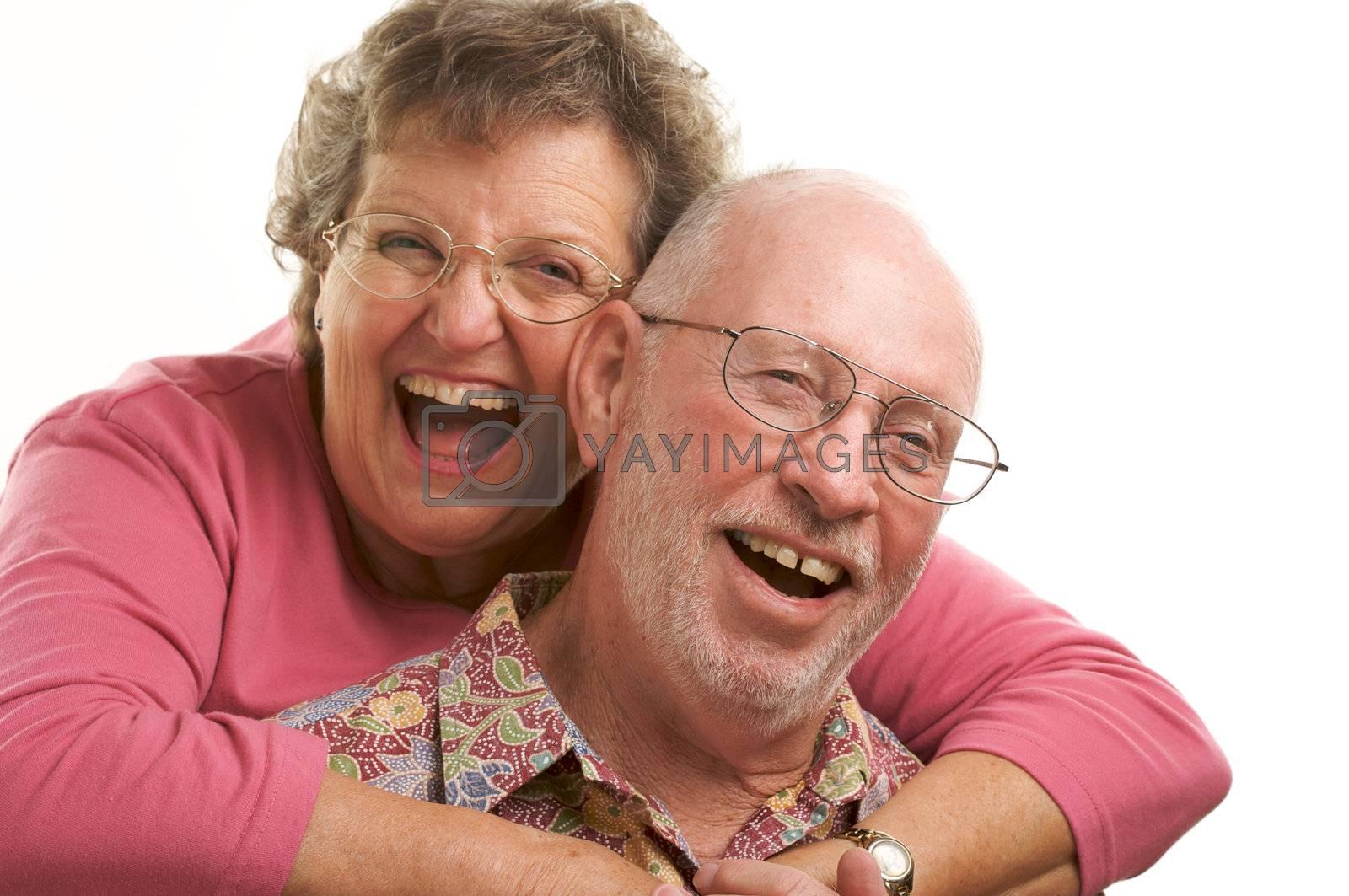 Happy Senior Couple poses for portrait.