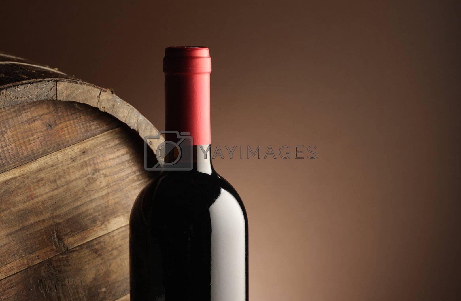 red wine bottle and wodden barrel