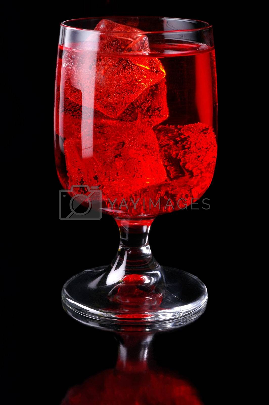 Glass of red drink with ice closeup (C3)