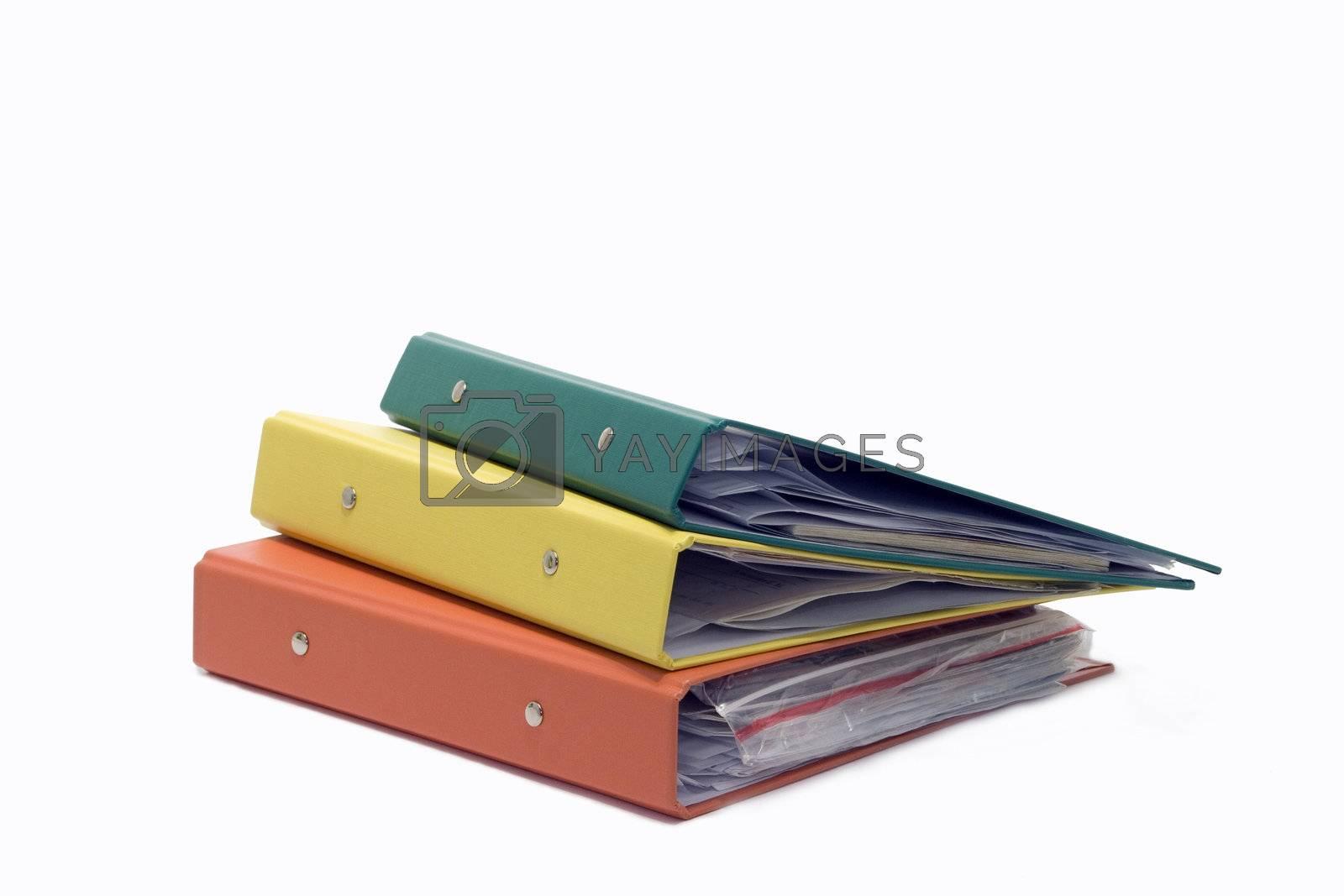 three plastic folders of a white background