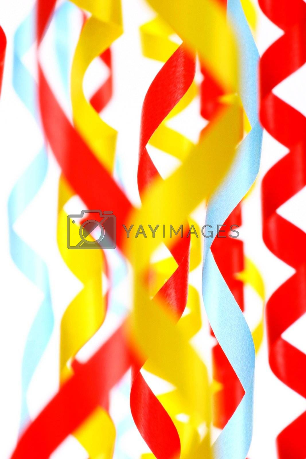 Celebratory Tinsel Of Red, Green And Yellow Color On White by yucas